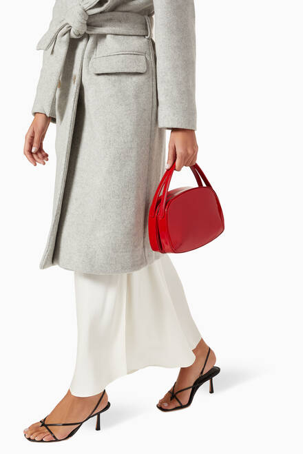 hover state of La Prima Top Handle Bag in Patent Leather