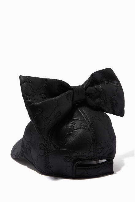 hover state of Matelasse Bow Cap in Faux Leather