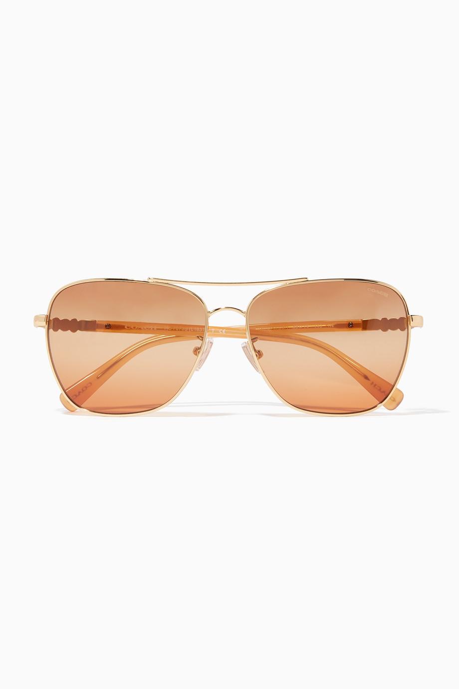 6540931bcd8b7 Shop Coach Brown Gold-Amber Daisy-Rivet Pilot Sunglasses for Women ...