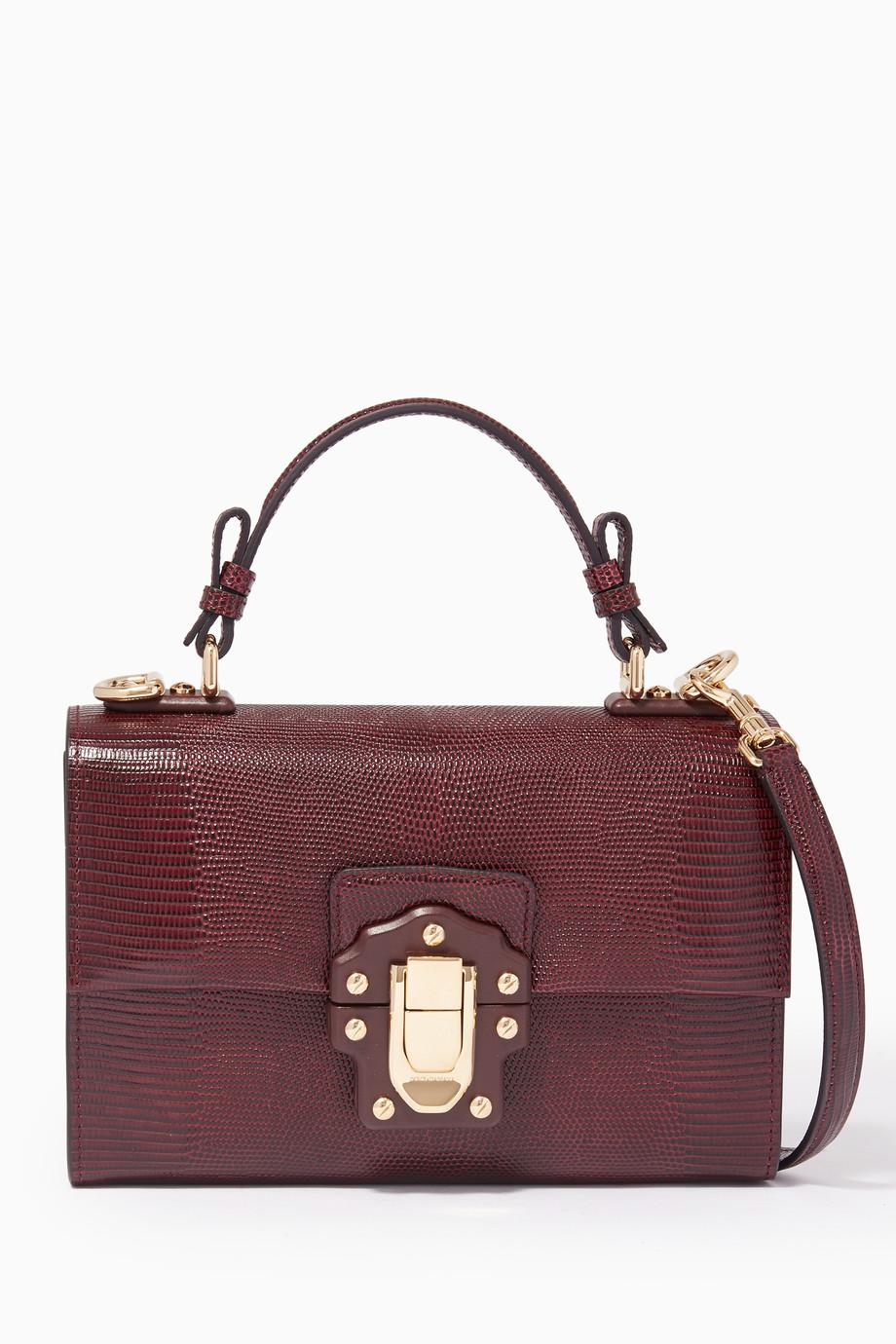 eccca0d9c609 Shop Dolce   Gabbana Purple Dark-Red Lucia Top-Handle Bag for Women ...