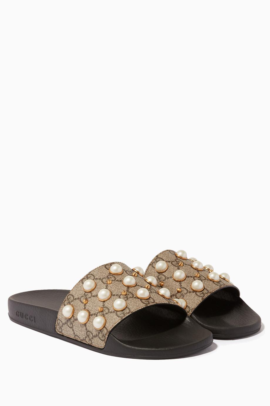 22028e294fe478 Shop Gucci Neutral Beige GG Supreme Pearl Slides for Women