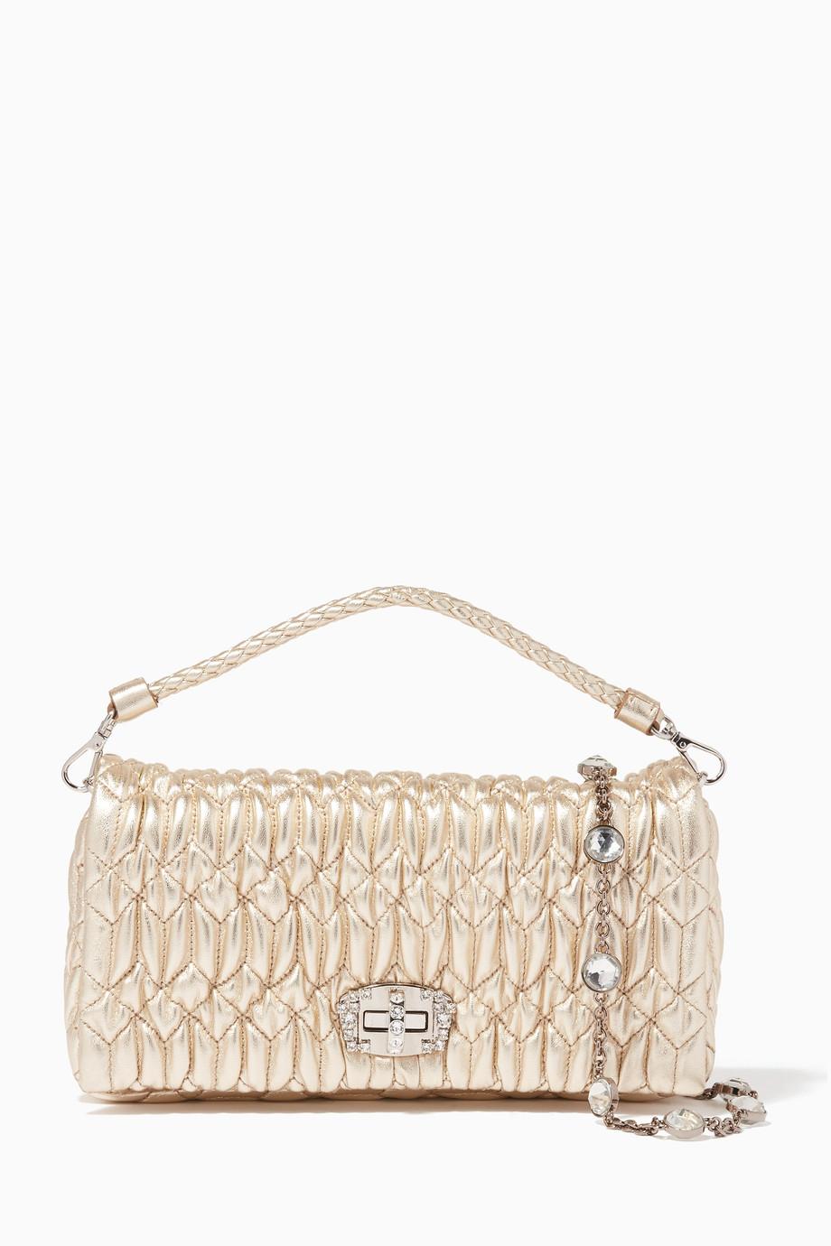ec60a3a90d8e Shop Miu Miu Gold Gold Matelassé Crystal-Embellished Leather ...