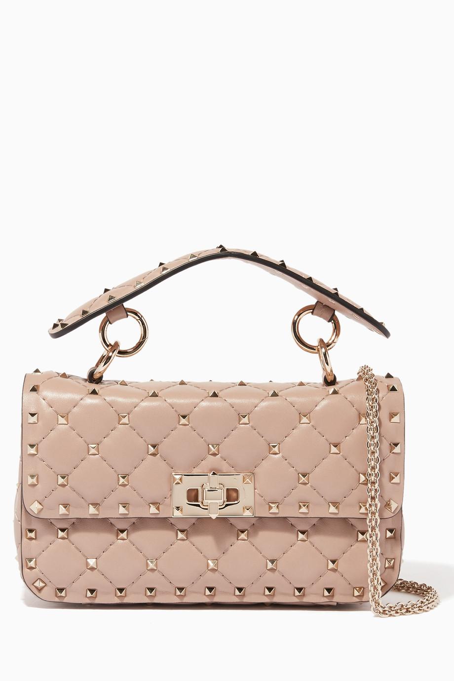 042fef38fee Shop Valentino Neutral Beige Small Rockstud Spike Matelasse Shoulder Bag  for Women | Ounass