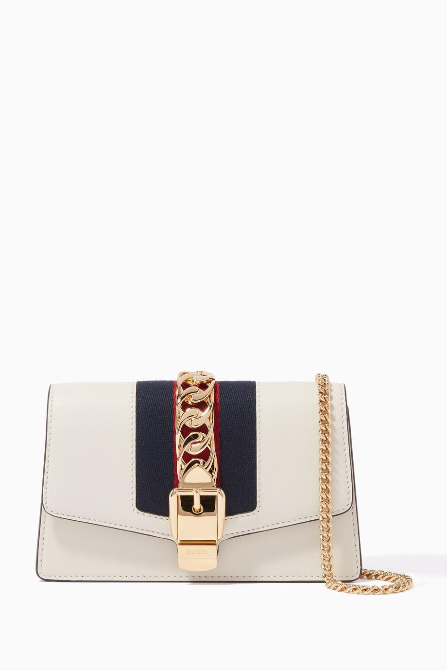 324e24519c9a6c Shop Gucci Neutral Ivory Sylvie Leather Chain Wallet Bag for Women ...