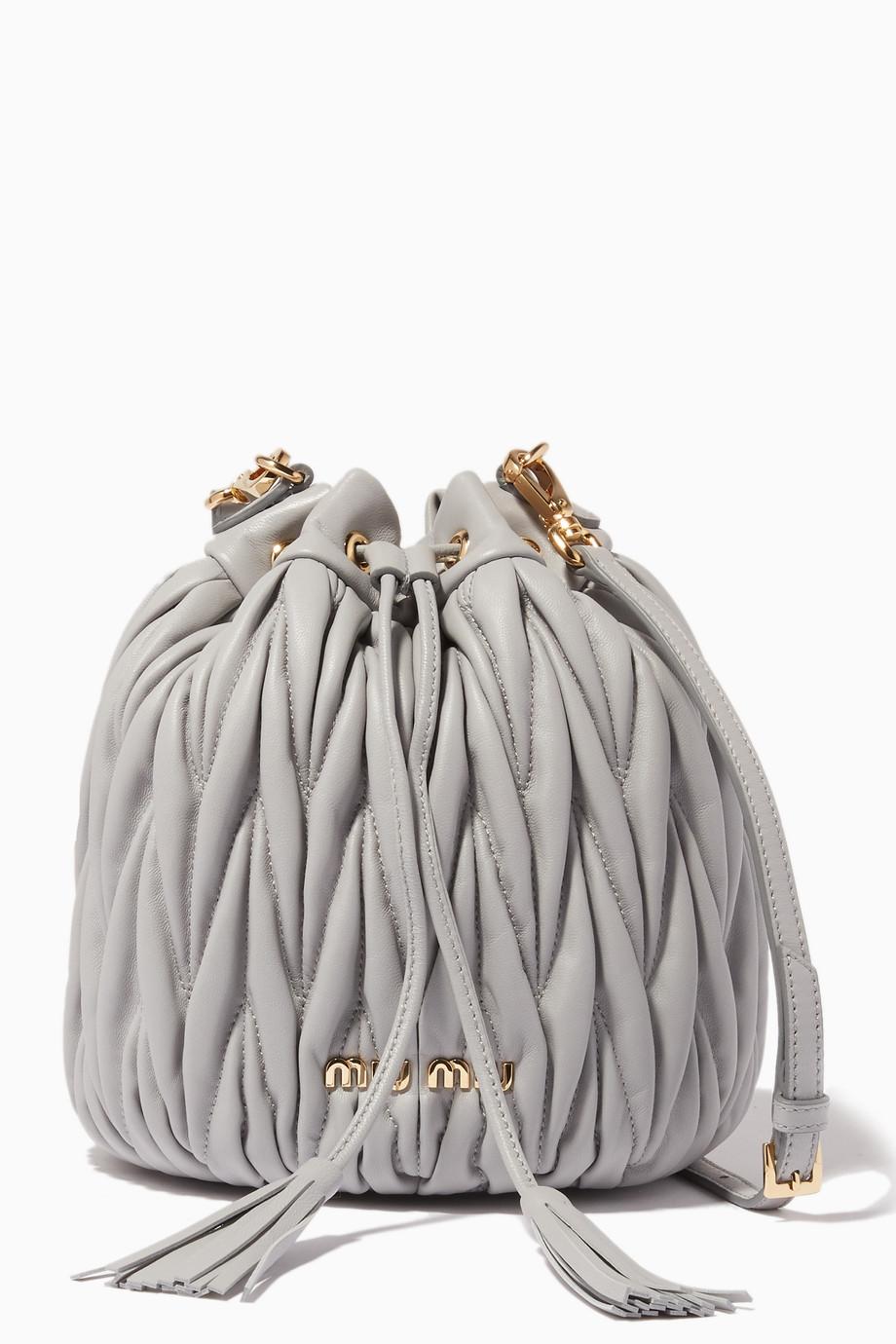 ccd9776273 Shop Miu Miu Grey Light-Grey Small Matelassé-Leather Bucket Bag for Women