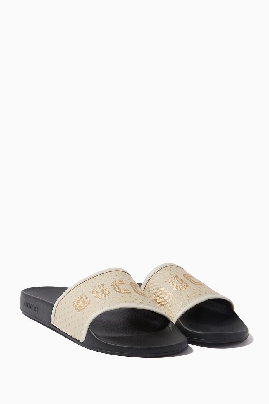 d1b1a2730c19 Shop Gucci White White Pursuit Guccy Rubber Slides for Women ...