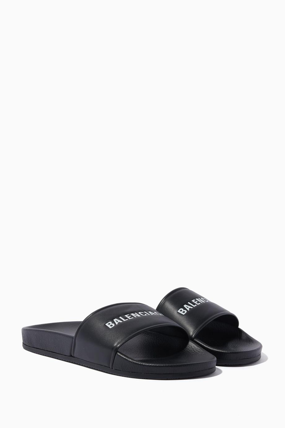 da25eea7f72c Shop Balenciaga Black Black Leather Logo Slides for Women