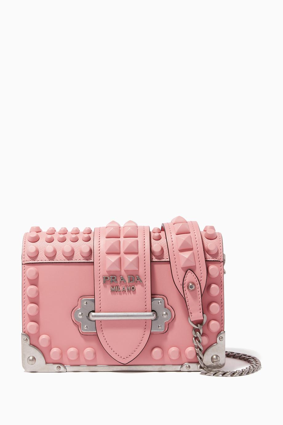 f536f69ead5ee Shop Prada Pink Petal-Pink Studded Mini Cahier Shoulder Bag for ...
