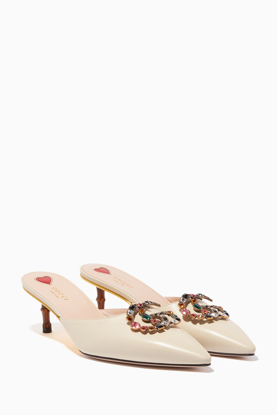 a190a3c4d00f Shop Gucci White White Unia GG Crystal Embellished Mules for Women ...