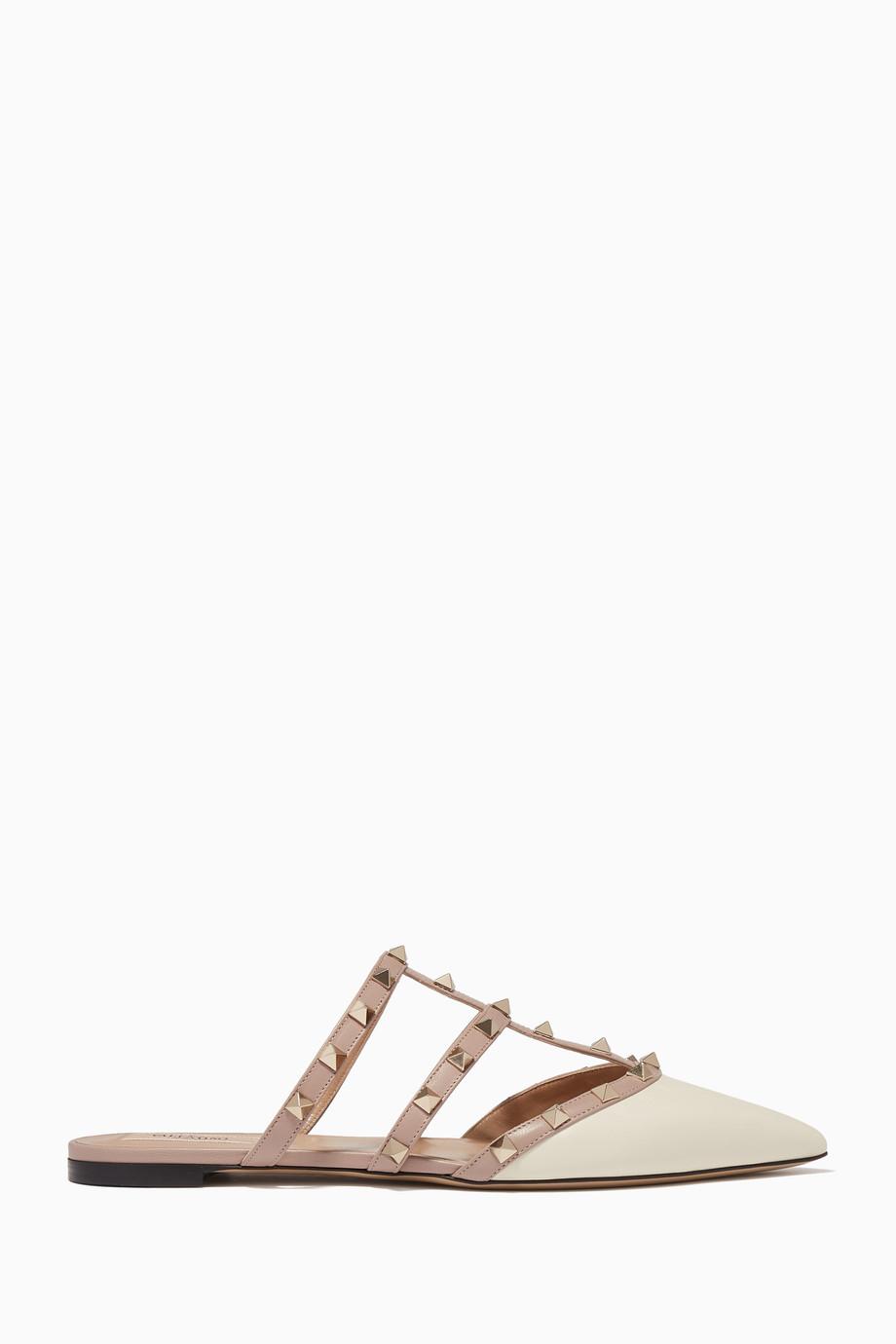 b55ecce3dcc2d Shop Valentino Neutral Rockstud Flat Mules for Women | Ounass UAE