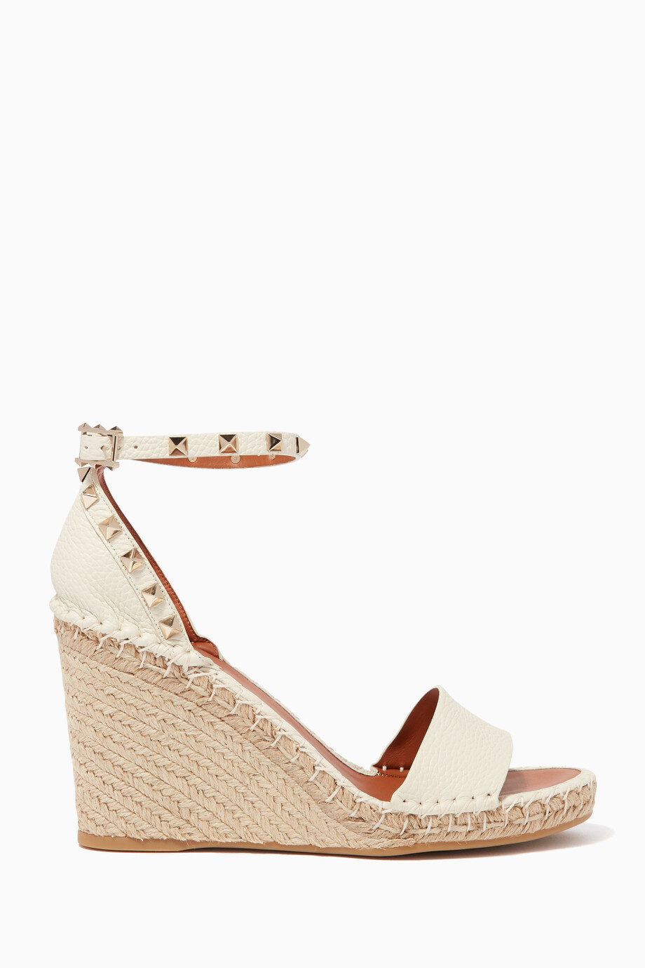0b765ae3b4c Shop Valentino Neutral Off-White Rockstud Leather Wedge Sandals for ...