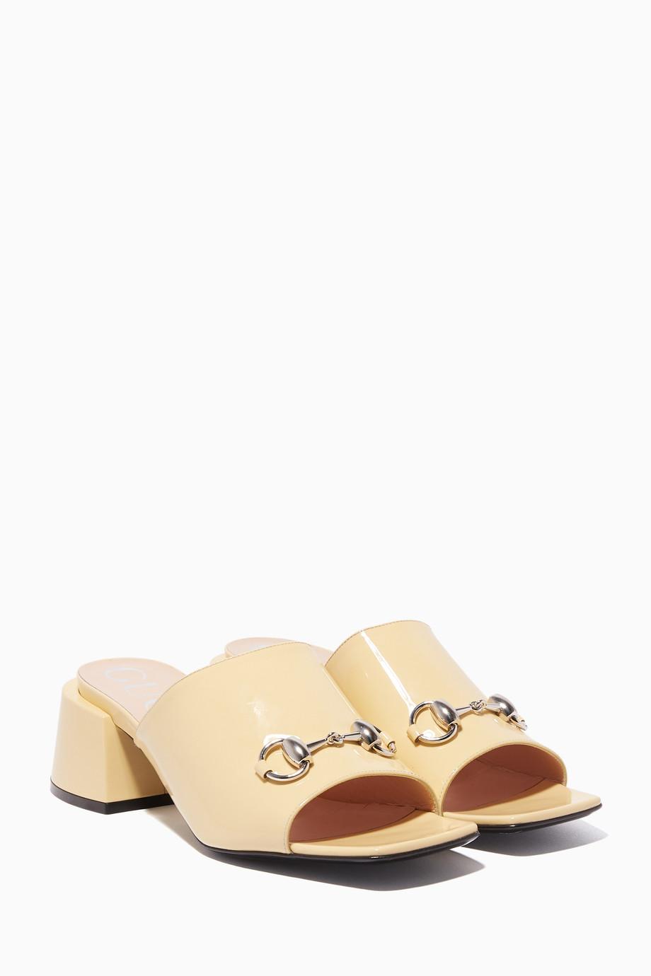baf50b0bf78 Shop Gucci Neutral Cream Patent Mid-Heel Slides for Women
