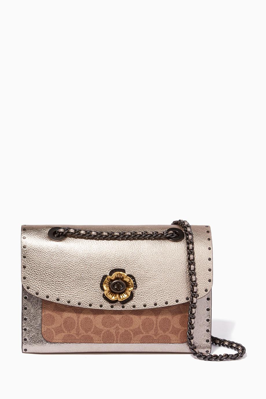 bdf710a61c7b5b Shop Coach Neutral Platinum Signature Canvas Parker Bag for Women ...