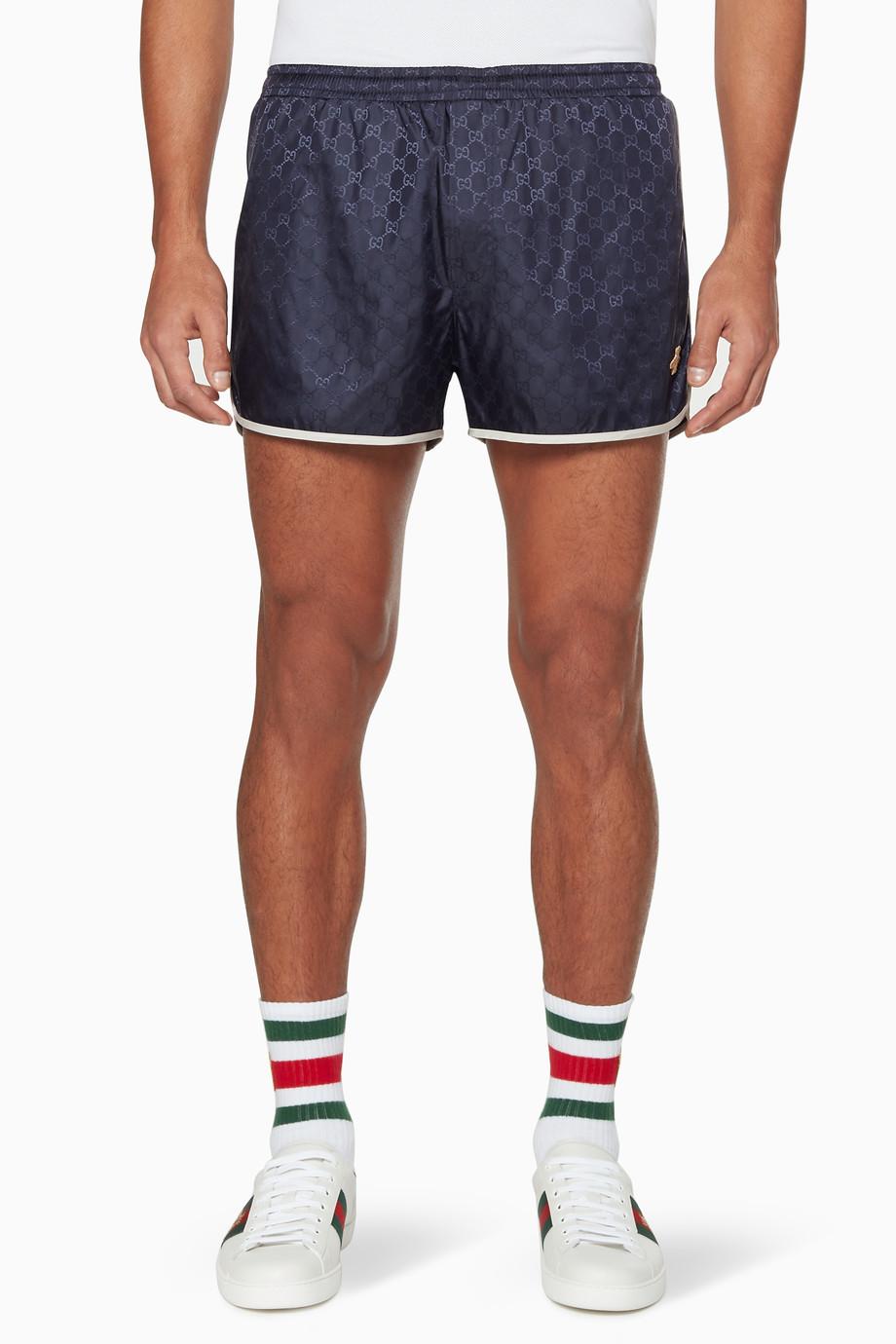 be67c945cf Shop Gucci Neutral Ink-Blue GG Swim Shorts for Men | Ounass