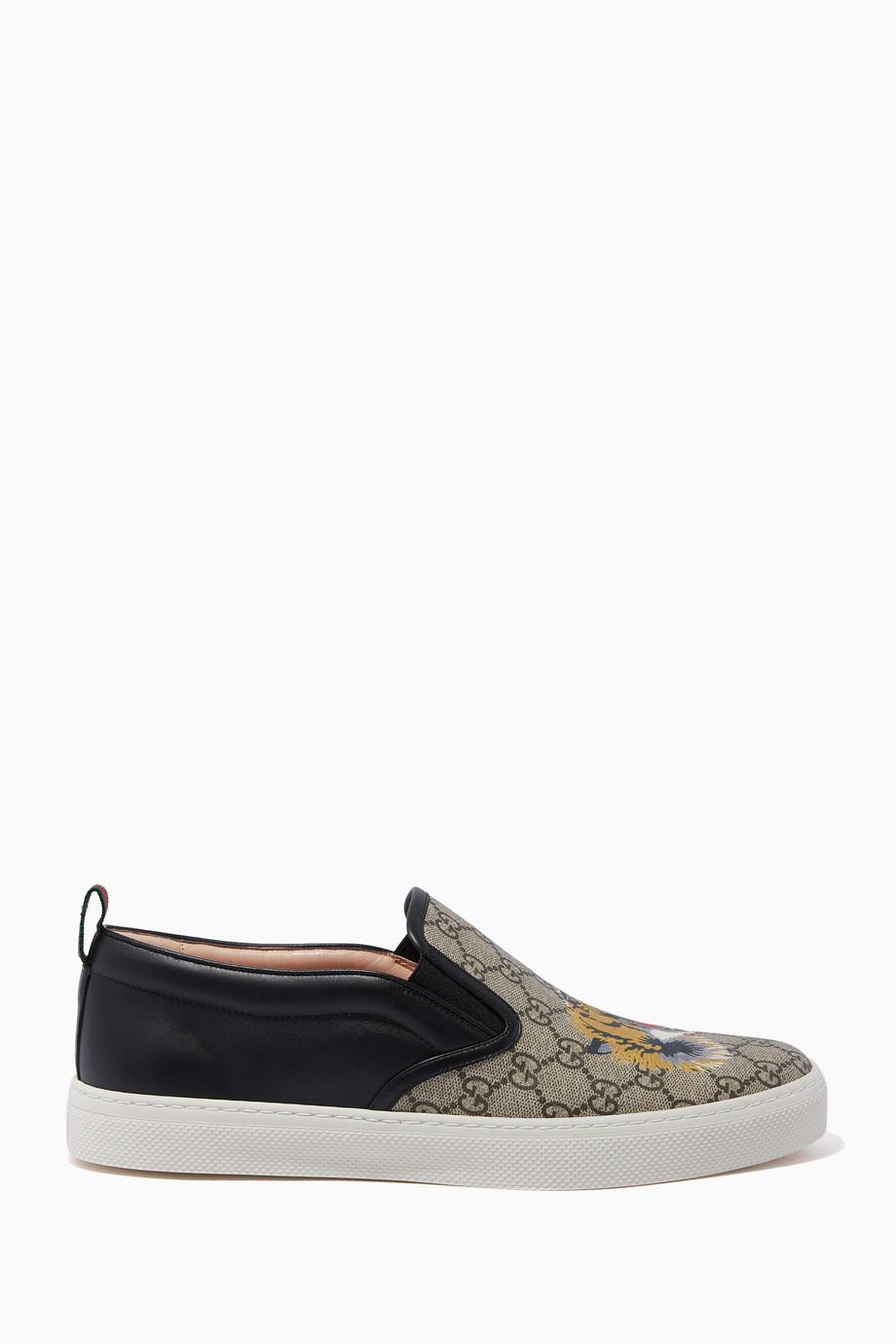 d238c98da1778 Shop Gucci Black Beige   Black GG Supreme Tiger Slip-On Sneakers for ...