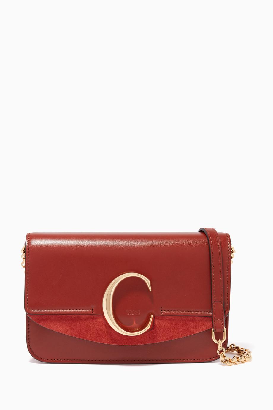5ce58ece51e Shop Chloé Brown Chloé 'C' Leather Clutch for Women   Ounass