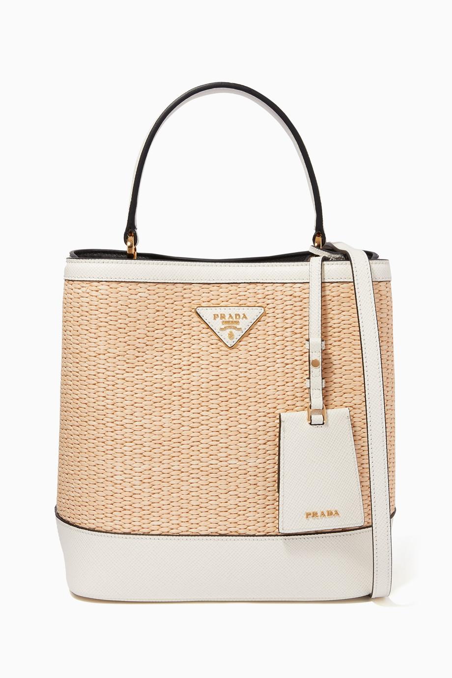 517f4c1eb2edc0 Shop Prada White Medium Straw & Saffiano Leather Bucket Bag for ...